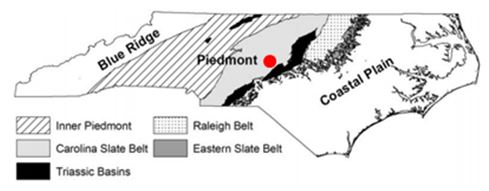 Glendon (red dot) within the Carolina Slate Belt of the Piedmont Terrain in central North Carolina.  Figure from Rogers (2006)