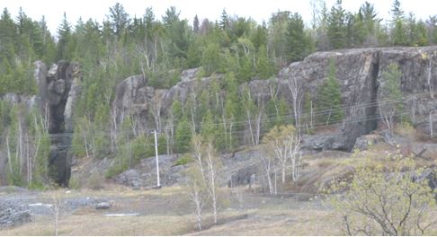The miners would simply extract the vein material only, leaving the barren hard host diabase on either side.  Note the two vein cuts in the steep cliff walls on either side of this picture taken facing east for town.