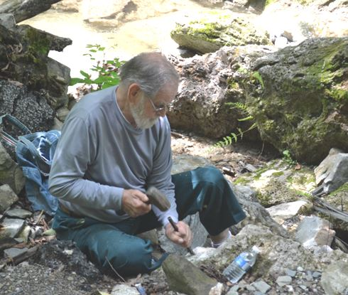 Ken Rowe continues to collect with the WCGMC. Here he is chiseling out a travertine piece on our June 26th trip to Ilion Gorge.