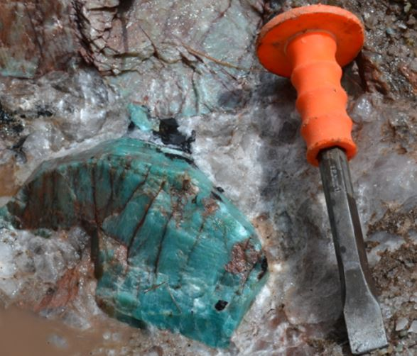 "At one location the feldspar is amazonite and one 6-8"" clot required some heavy digging.  The surrounding quartz did not yield its treasure easily, The chisels and the chisellers got a workout, but eventually this little piece of Canada did go back to the US."