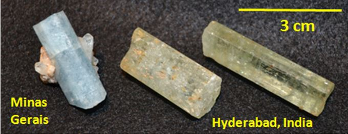 Note the effect of Fe+3 in the color of the pair of aquamarine from India.  (Fred Haynes collection)