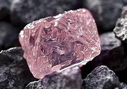 Many of the best and largest pink diamonds have been found in the Argyle Diamond Mine in the Kimberley region of Western Australia.  The 12.76 carat raw pink diamond shown here was found in 2015 and have been named the Argyle Pink Jubilee.  It rivals the best and largest pink diamonds ever found.  (Photo from Amazing Geology webpage)