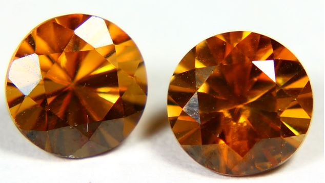 Hyacinth is a name often used in conjunction with gem quality yellow of brown red zircon such as this pair of 3.4 ct round cut gems from Cambodia.