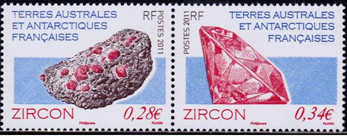 This pair of 2011 stamps from the French Southern and Anarctive Territory demonstrate the natural occurrence of zircons embedded in host granite (left)  and a cut gemstone (right).