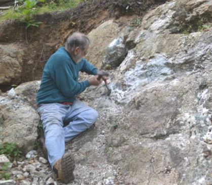 Ken Rowe has found a comfortable spot and a diopside crystal.  Now all he has to do is chisel it out!