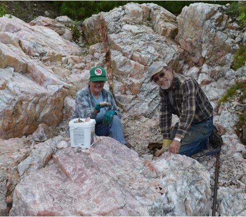 The owners of the Rose Quartz Pit, Renee and Dick Paterson surrounded by gemmy rose quartz exposed by blasting during the summer of 2013.