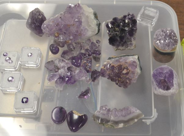 Ed displayed amethyst in all its forms from raw crystalline mineral specimen, to polished cabochons, to fully faceted gems.  All in view are his creations, well after mother nature did her part.