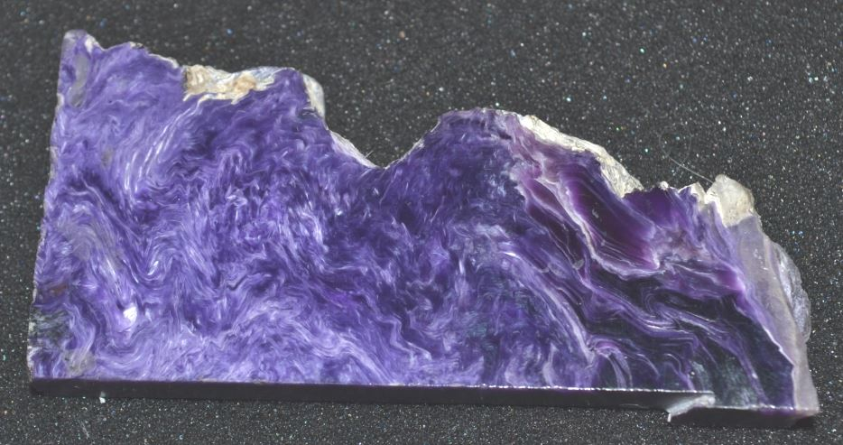 """In full disclosure, I had to look up charoite when Glenn displayed this 3"""" wide polished slab."""