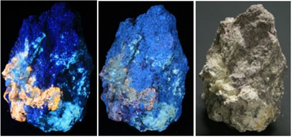 """This 4"""" by 3"""" specimen from the downhill site appears in long wave at left (bright yellow scapolite with blue analcime), short wave in the center (dull blue diopside) and room light   All photos were taken with a tripod mounted Canon I2 megapixel digital SLR, using the camera's automatic focus and settings. The specimens were set on black foam core board.  The SW pictures were lit by a pair of 95 watt lamps set to either side, while the LW shots deployed a pair of hand held lights, perhaps 20 watts in total, arranged much closer to the specimens."""