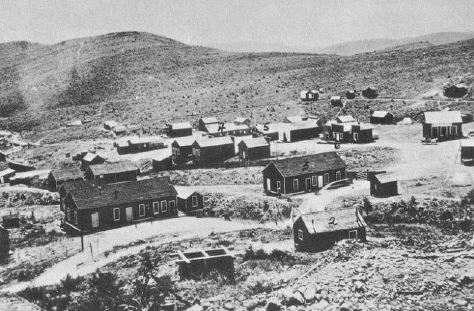 Total Wreck, Arizona in 1885 – Now a ghost town at the end of a virtually impassable 4-wheel drive trail, Total Wreck once was the home of five saloons, three stores and over 200 miners and prospectors.  The prize was silver and over half a million dollars of the metal were extracted in about two decades. In the lower photo from 2011 all that remains are some mine dumps, some open adits and shafts, and a few overgrown dirt trails.  (Both photos from Rose, 2013)