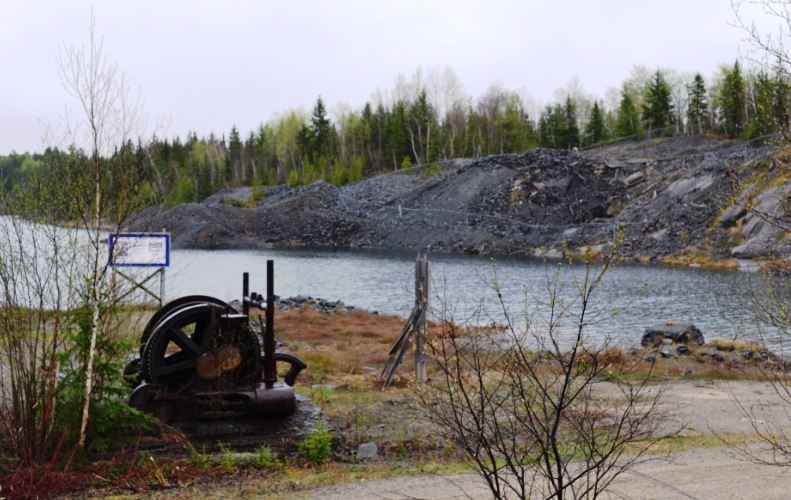 A typical scene from Cobalt:   Remains from the Crown Reserve Mine in the foreground, and mine dumps from the Kerr Lake Mine across the lake.