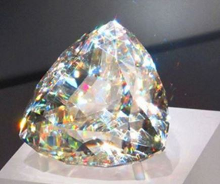 This may look like a faceted diamond, but it is not.  This mineral has a hardness of 3.5.  It is cerussite (PbCO3) and this is the world's largest faceted cerussite.  The Royal Ontario Museum in Toronto owns this 896 carat piece of lead ore from Tsumeb, Namibia.  Picture is from the Amazing Geology Facebook page (see page 4).