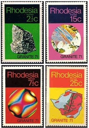 The African nation of Rhodesia honored an international Geology Seminar on Granites held in Salisbury in 1971 by issuing a series of four stamps.  The 2 ½ cent issue on the upper left depicts a simple granite hand sample.  The 15 cent variety set on pink shows a thin section view of muscovite and quartz viewed with plane polarized light.  The muscovite shows pleochroism while the quartz is clear.  A beautiful biaxial interference figure from a single muscovite grain is depicted on the 7½ cent stamp.  This interference pattern occurs when a flake of muscovite is viewed with both polarizers in place.  The final 25 cent stamp in the set shows a geologic map of Rhodesia with the various granites colored red and orange.  The famous gold belts in Rhodesia are depicted in green.