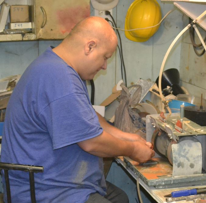 Robert Webster at work on one of the grinding wheels at the WCGMC workshop in December.